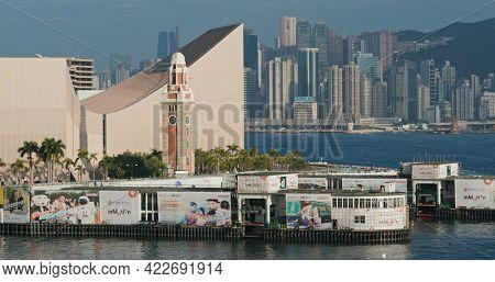 Victoria Harbor, Hong Kong 04 February 2021: Hong Kong clock tower