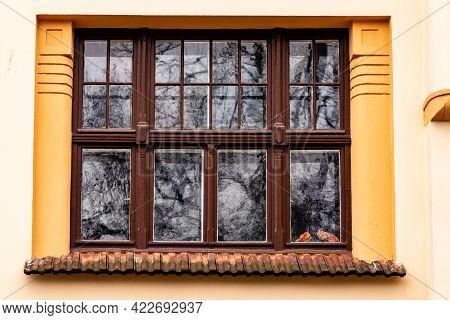 Art Nouveau Window. Brown Window Frame At Yellow Vintage Building. Historic Window At Riga, Latvia,