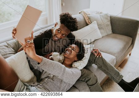African American couple taking a selfie