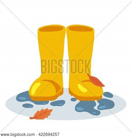 Yellow Rubber Rain Boots In A Front View With Water Splashes And Yellow Leaves. Concept Of Rainy Wea