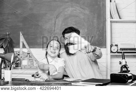 Man Bearded Pedagogue And Pupil Having Fun. School Learners Leisure. Developing Caring Learners Who