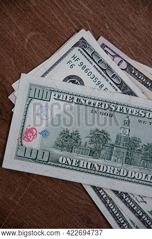 Closeup American Cash Banknotes Of 50 Dollars And 100 Dollars Bill Marked By Inked Symbols. Red And