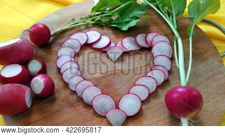 Close-up Heart Of Radish Slices. Early Root Vegetables For Making Dietary Vitamin Salad. Organic Veg