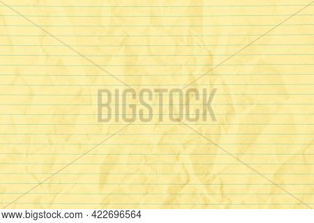 Yellow crumpled lined paper background