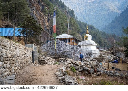 Lukla, Nepal - March 4, 2021: A Buddhist Stupa Along The Trail From Lukla To Namche Bazaar In The Mo
