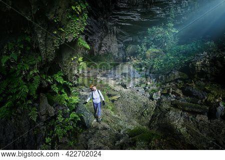 Woman Traveler Explores Beautiful Hang Tien Cave In Phong Nha Ke National Park. Vietnam