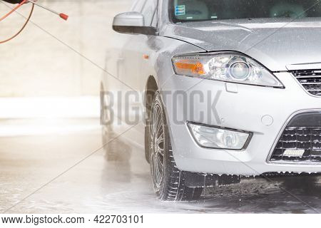 High Pressure Cleaning Car In Exterior Washbasin.