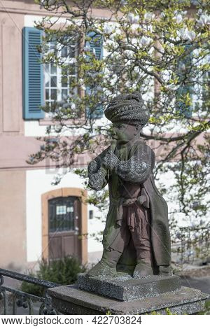 Frankfurt, Germany - April 24, 2021: Old Sandstone Figures Showing Young Arabic Musicians In Style O