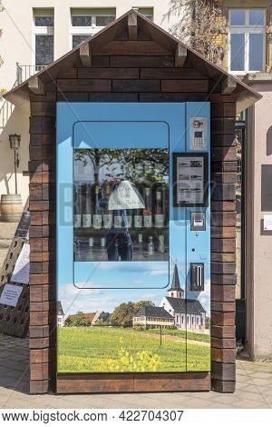 Hochheim, Germany - April 25, 2021:wine Vending Machine In Hochheim With Picture Of Hochheim Vineyar