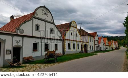 Traditional Houses In Village Called Holasovice In South Bohemia Lined Up By The Road Going Around V
