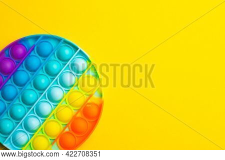 Pop It Anti-stress On A Yellow Background. Modern Toys. Toys For Children. Silicone Game. Autism. Tr