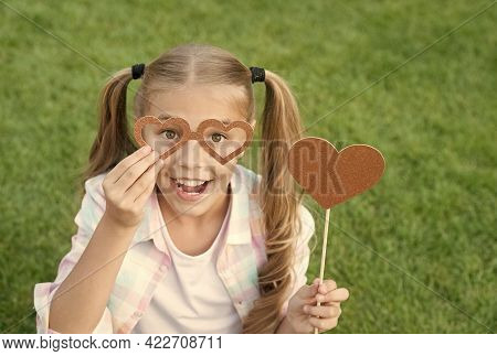 Make Your Photo Booth More Fun. Happy Child Have Fun On Green Grass. Party Girl Hold Fun Glasses And