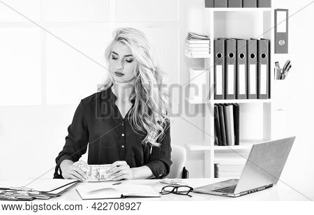 Owner Of Small Business. Girl In Office Analyzing Financial Report. Low Income. Strict Money Account