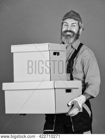 New Home. Unpacking Moving Boxes. Moving Day. Bearded Man Courier Hold Boxes. Moving To New Apartmen