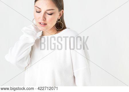 Cheerful woman wearing white sweater