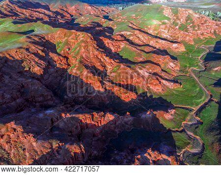 Scenic Aerial View Of Green Valley In Red Sandstone Rocks Of Fairy Chimneys In Narman Valley. Erzuru