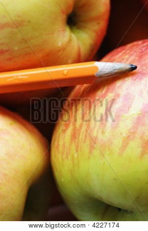 Pencil On Apples