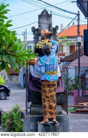Balinese Woman With Hindu Offerings To Gods, Bali, Indonesia.