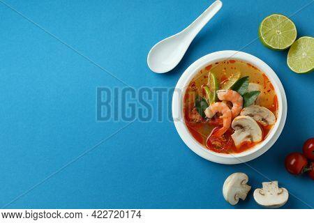 Tasty Tom Yum Soup On Blue Background