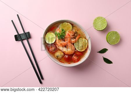 Tasty Tom Yum Soup On Pink Background