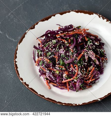 Mixed Fresh Vegetables And Greens On Clay Plate. Top View. Vitamin Salad Of Red Cabbage, Carrots Or
