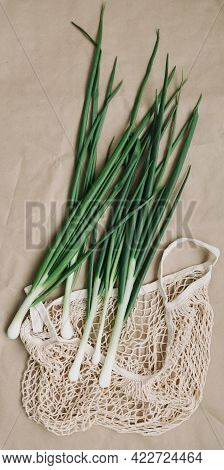 Fresh Green Onions And Scallion In Eco Friendly Bag Top View, Flat Lay. Eco Lifestyle, No Plastic Li