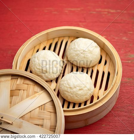 Chinese Buns On Bamboo Steamer. Cooking Pan-asian Bread. Round Pieces Or Balls Of Raw Dough On Woode