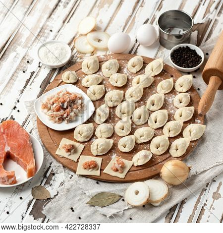 Dumplings Stuffed With Red Salmon Fish. Omega Seafood. Cooking Process. Ingredients And Kitchen Uten