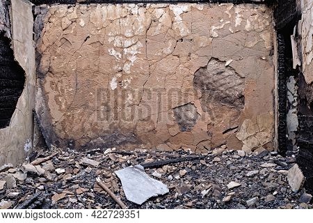 Burned And Ruined House Interior After Fire, Consequences Of Fire Disaster Accident. Wall After A St