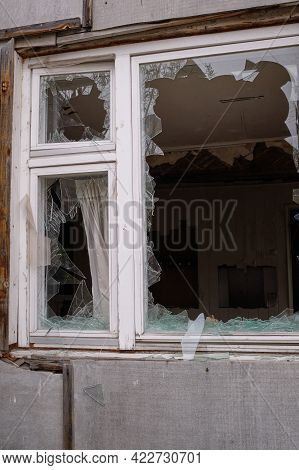 Window With Broken Glass In Abandoned House. Old Broken Window Of An Old Building