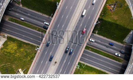 Flight Over A Multi-level Road Junction. Public Transport Is Visible. City Aerial Photography.