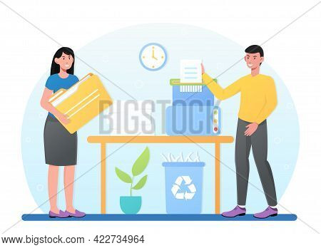 Young Male And Female Businesspeople In Office Putting Secret Document To Shredder. Concept Of Destr