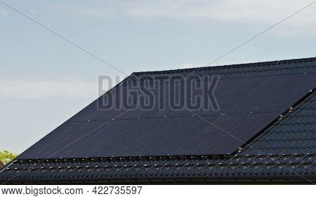 Installing Modern Black Solar Panels On The Roof