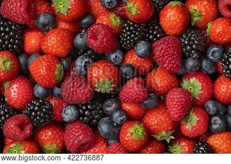 Variation of mixed summer fruit, strawberries, blueberries, raspberries and  blackberries close up full frame