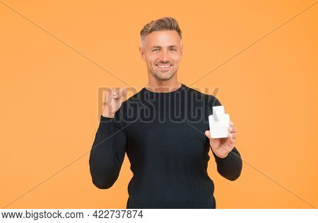 Confident About The Way He Looks. Confident Guy Present Cologne Gesturing With Confidence. Skincare