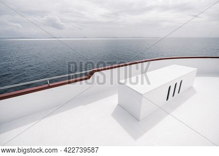 A Wide-angle View From The Upper Deck Of A Safari Yacht With A Rectangular Box Bench With Three Hole