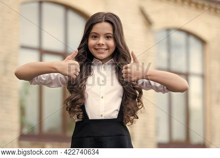 I Strive For The Best Education. Happy Child Show Thumbs Ups. Back To School. Formal Education. Scho