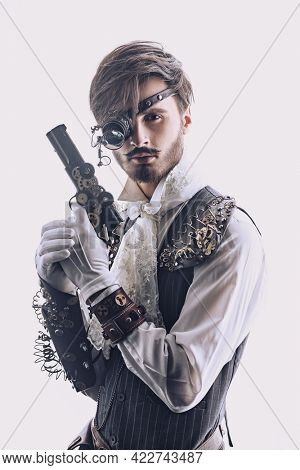 Portrait of a handsome noble man with steampunk gadgets and a gun on a white background. Steampunk concept.