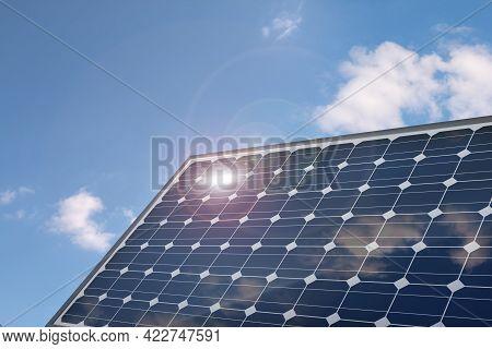 Photovoltaic Solar Power Panel On A Blue Sky. 3d Illustration.