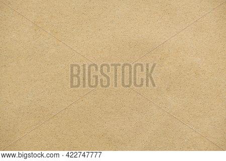 Light brown sandpaper surface texture background