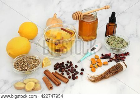 Immune boosting hot drink for cold an flu virus remedy with honey, lemon, ginger, ginseng, hibiscus, eucalyptus, echinacea, turmeric, hawthorn berries and cinnamon. High in antioxidants and vitamin c.