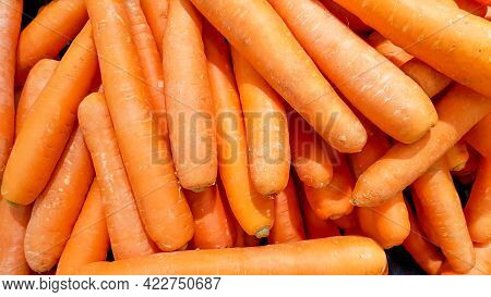 Carrots Placed In A Stall For Sale.macro Photo Spring Food Vegetable Carrot. Texture Background Of F