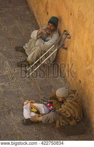 Chefchaouen, Morocco. 24 September 2017. Beggars Sitting In The Street Of The Town Of Chefchaouen.