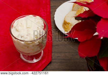 Apple Salad With Cream. Bowl With Apple Salad On Wooden Table With Poinsettia.