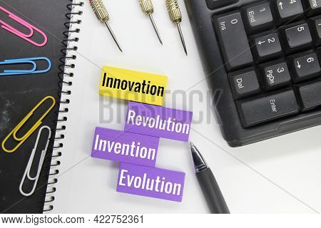 Colored Blocks And Keyboards With The Words Innovation, Revolution, Evolution And Invention