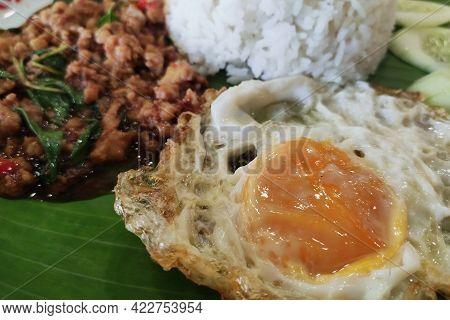 Close Up Rice Topped With Stir-fried Pork And Basil.thai Street Food.stir Fried Basil.