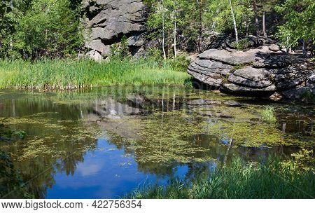 Mokhovoe Lake In The Mountains. Nature Of Mount Kolyvan. Altai Krai, Siberia, Russia.