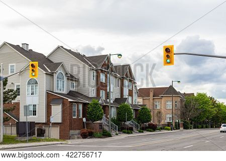 Canada, Ottawa -june 2, 2021: Street With Houses And Traffic Lights At Pedestrian Crossing In Ottawa