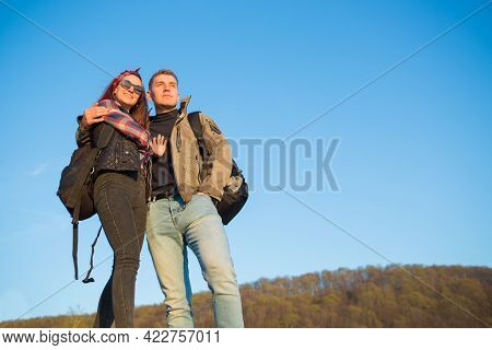 Hikers With Backpacks Enjoying Valley View From Top Of A Mountain Hiking In The Mountains
