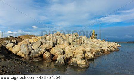 Foxton Beach, Horowhenua, New Zealand, 05.14.2021. Yellow Excavator Doing The Digging Work On Buildi